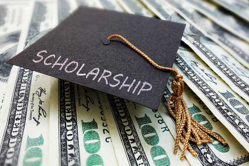 Scholarship graduation cap with cash